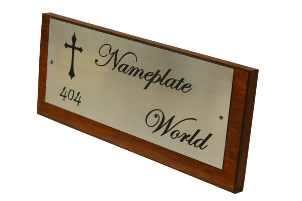 Nameplate with cross symbol